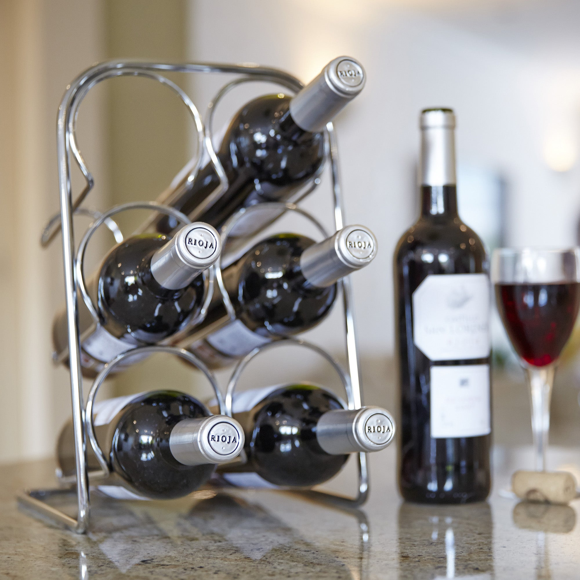Click to view product details and reviews for Hahn Pisa Chrome 6 Bottle Wine Rack Chrome.