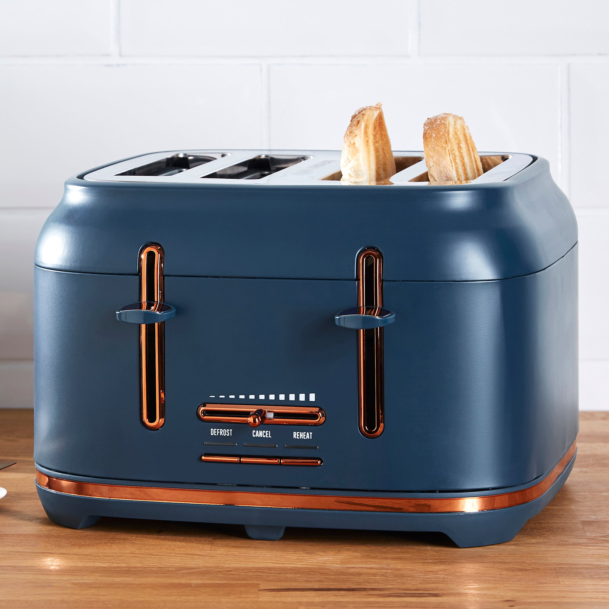 Click to view product details and reviews for Dunelm 4 Slice Matt Navy Copper Toaster Navy.