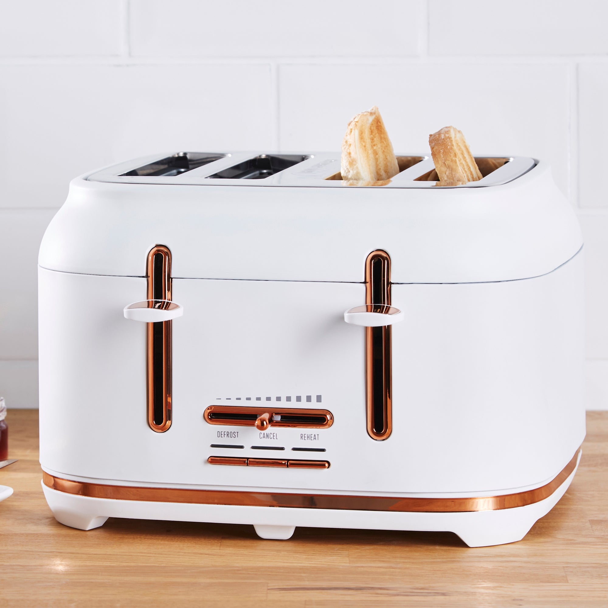 Click to view product details and reviews for Dunelm 4 Slice Matt White Copper Toaster White.