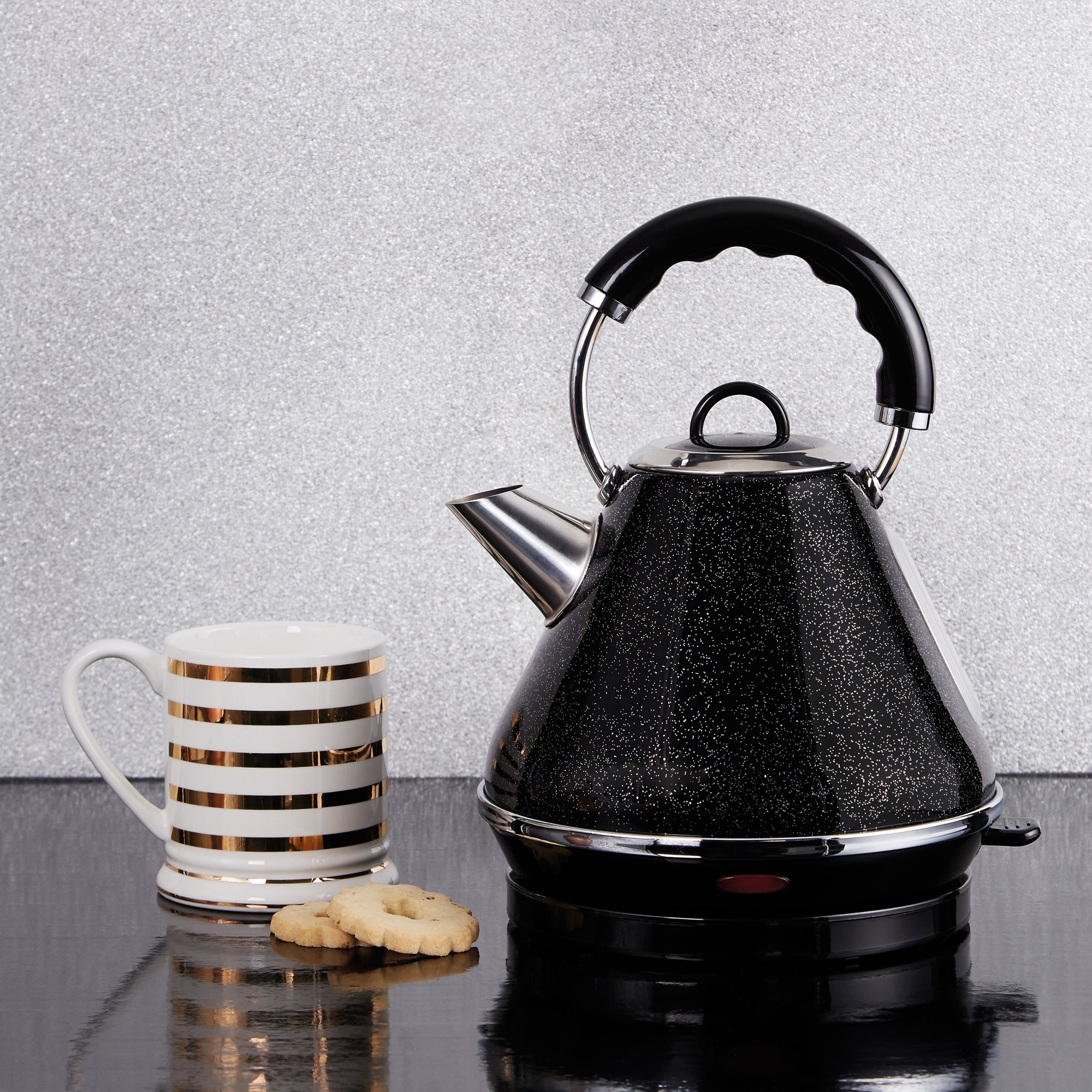 Click to view product details and reviews for Dunelm Bling 17l Black Pyramid Kettle Black White And Silver.