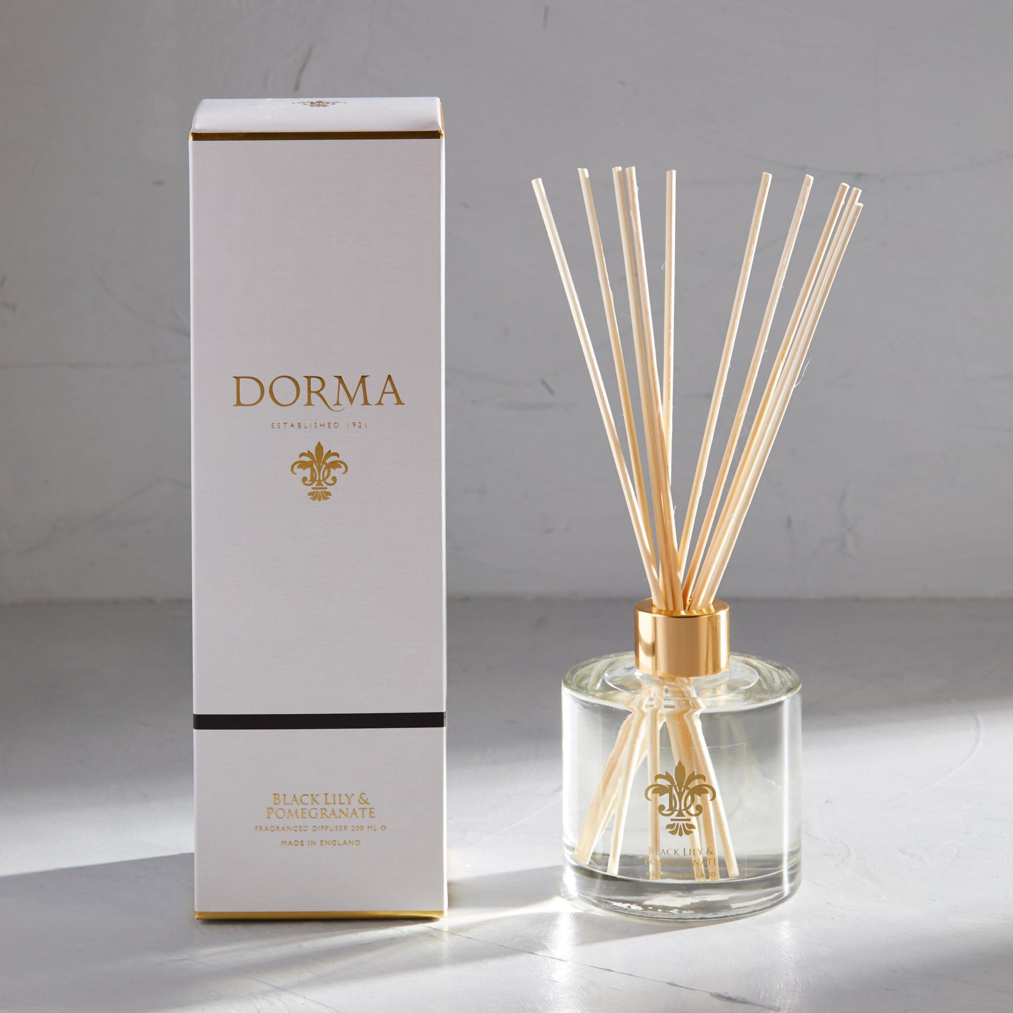 Click to view product details and reviews for Dorma Black Lily Pomegranate 200ml Reed Diffuser White.