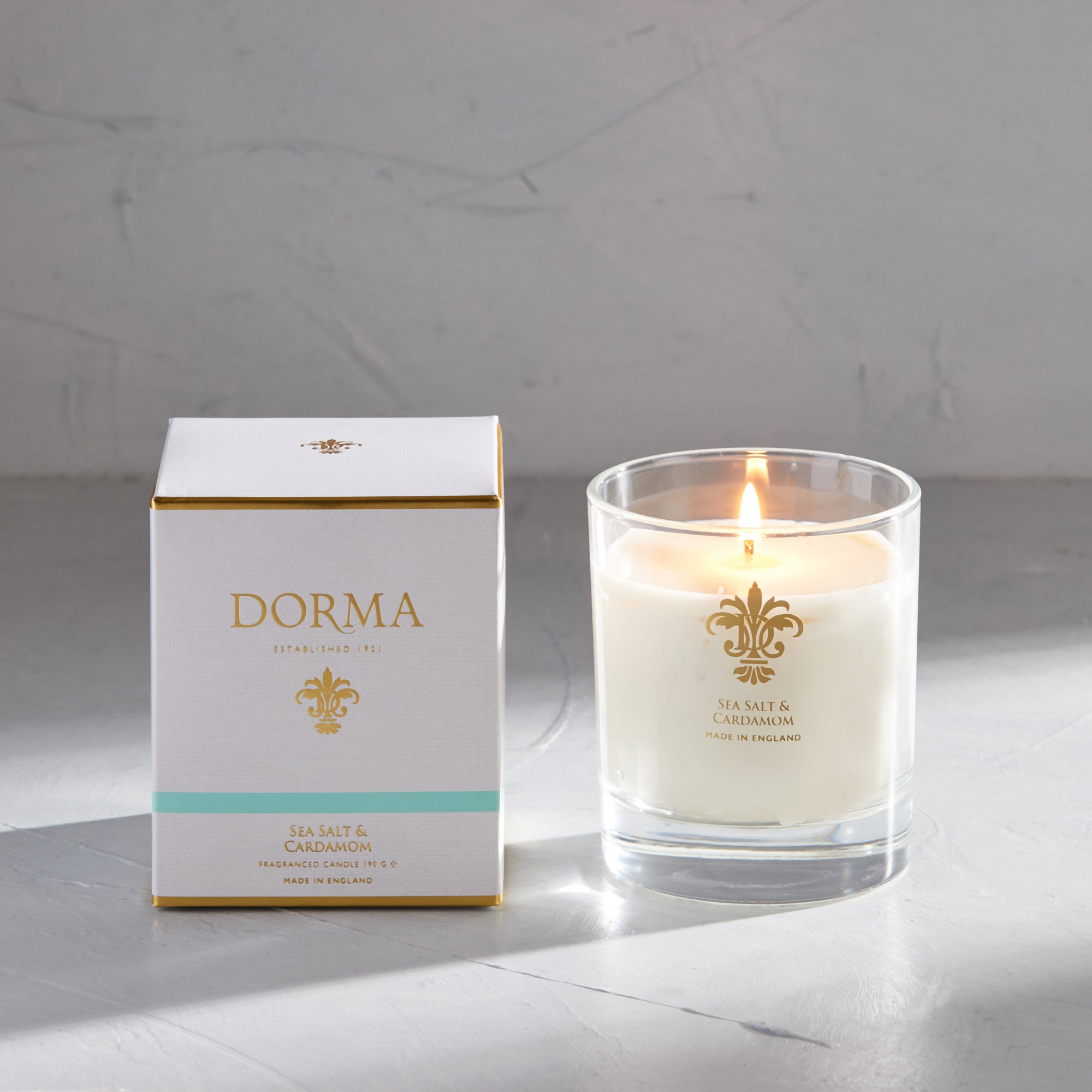 Click to view product details and reviews for Dorma Sea Salt And Cardamom Wax Fill Candle White.