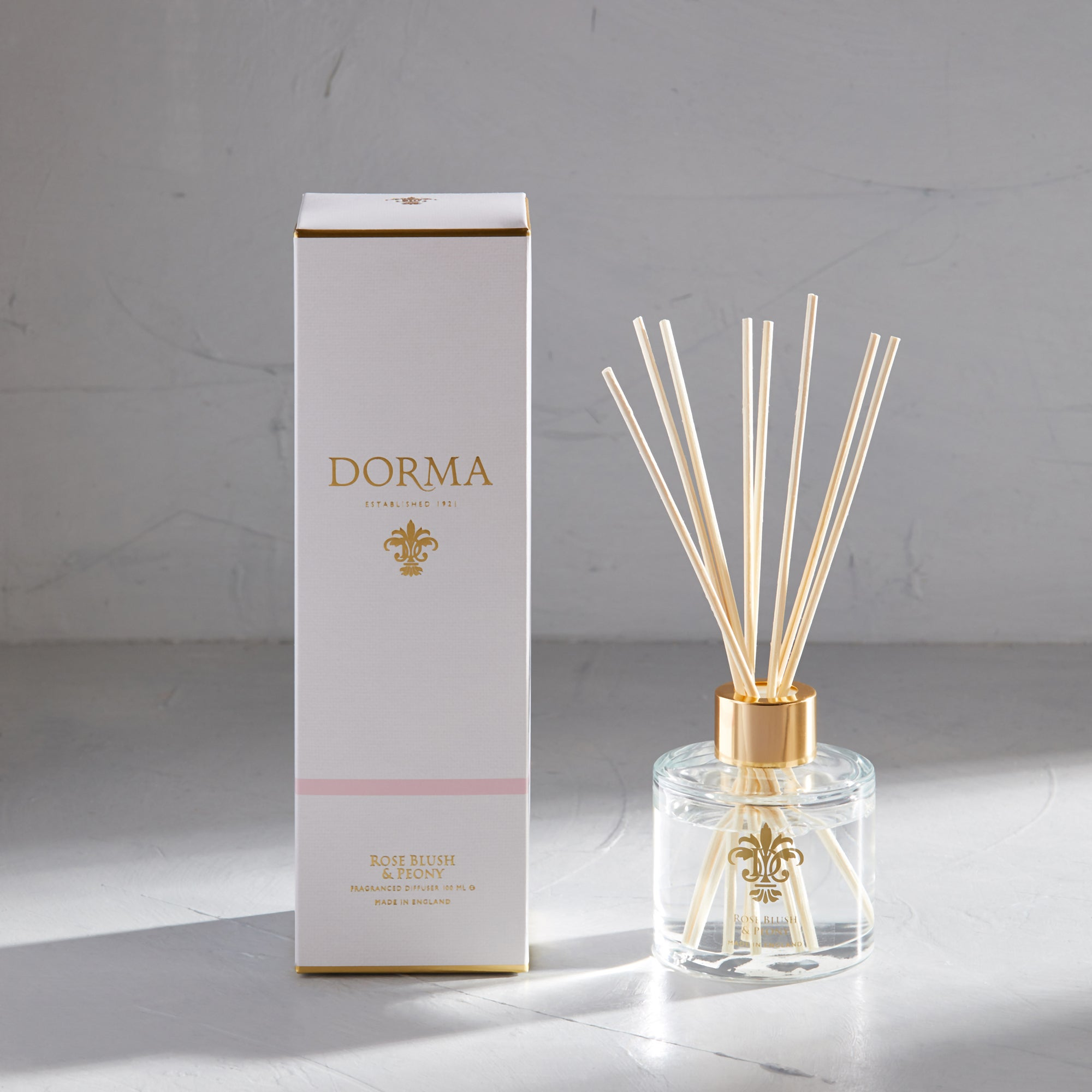 Click to view product details and reviews for Dorma Rose Blush And Peony 100ml Reed Diffuser White.