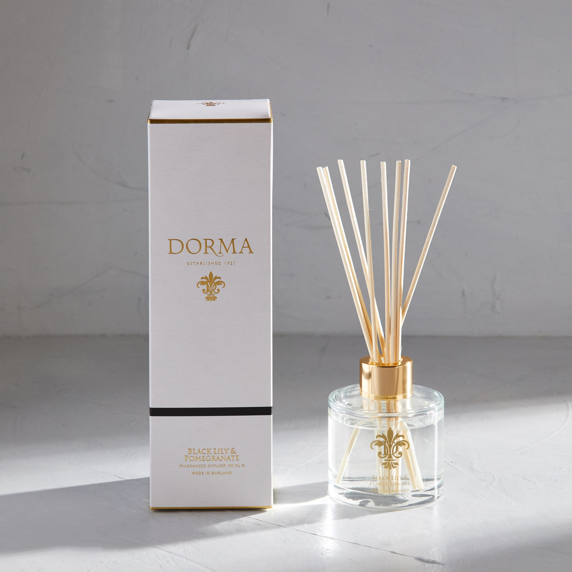 Click to view product details and reviews for Dorma Black Lily Pomegranate 100ml Diffuser White.