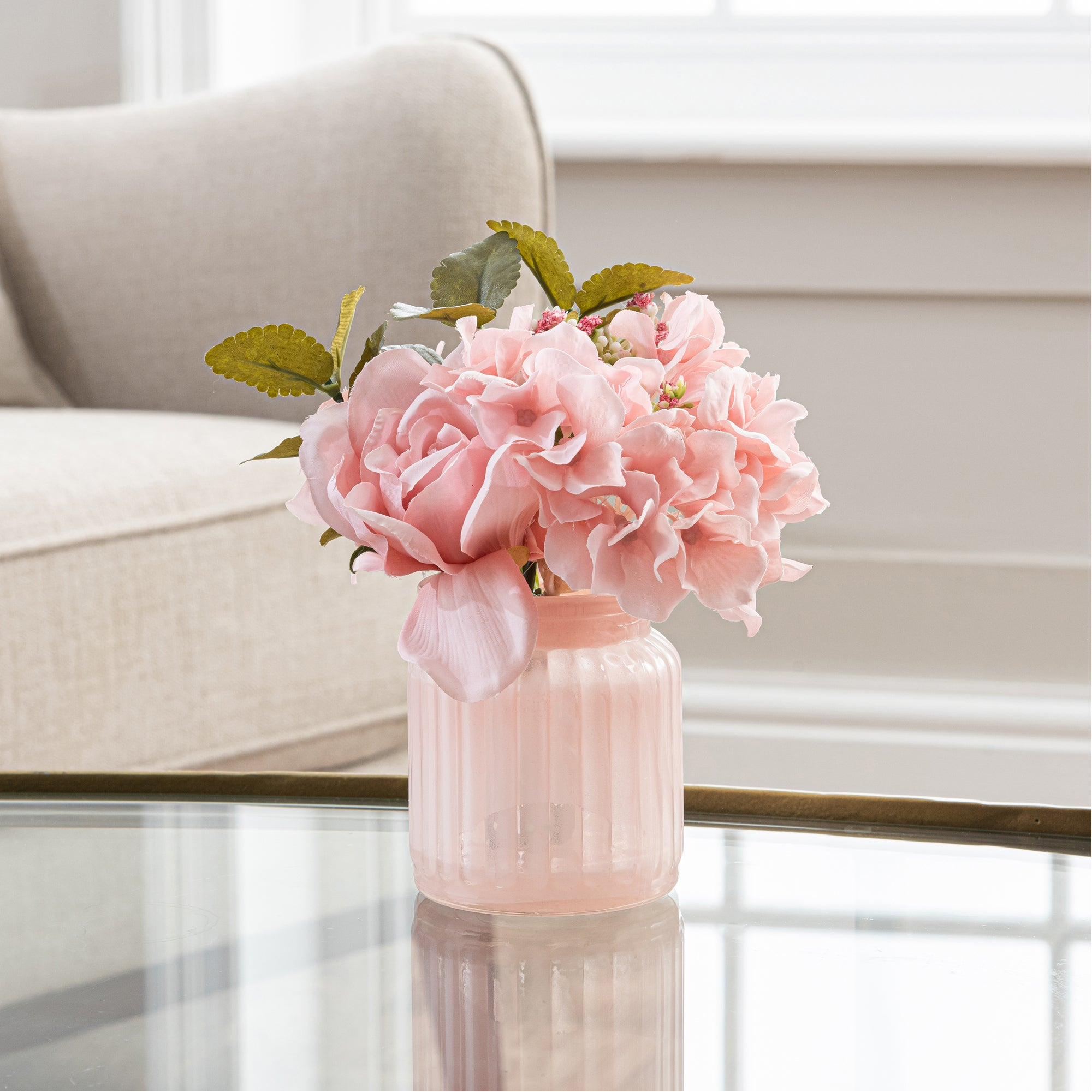 Click to view product details and reviews for Artificial Roses Arrangement In Pink Vase 15cm Pink.