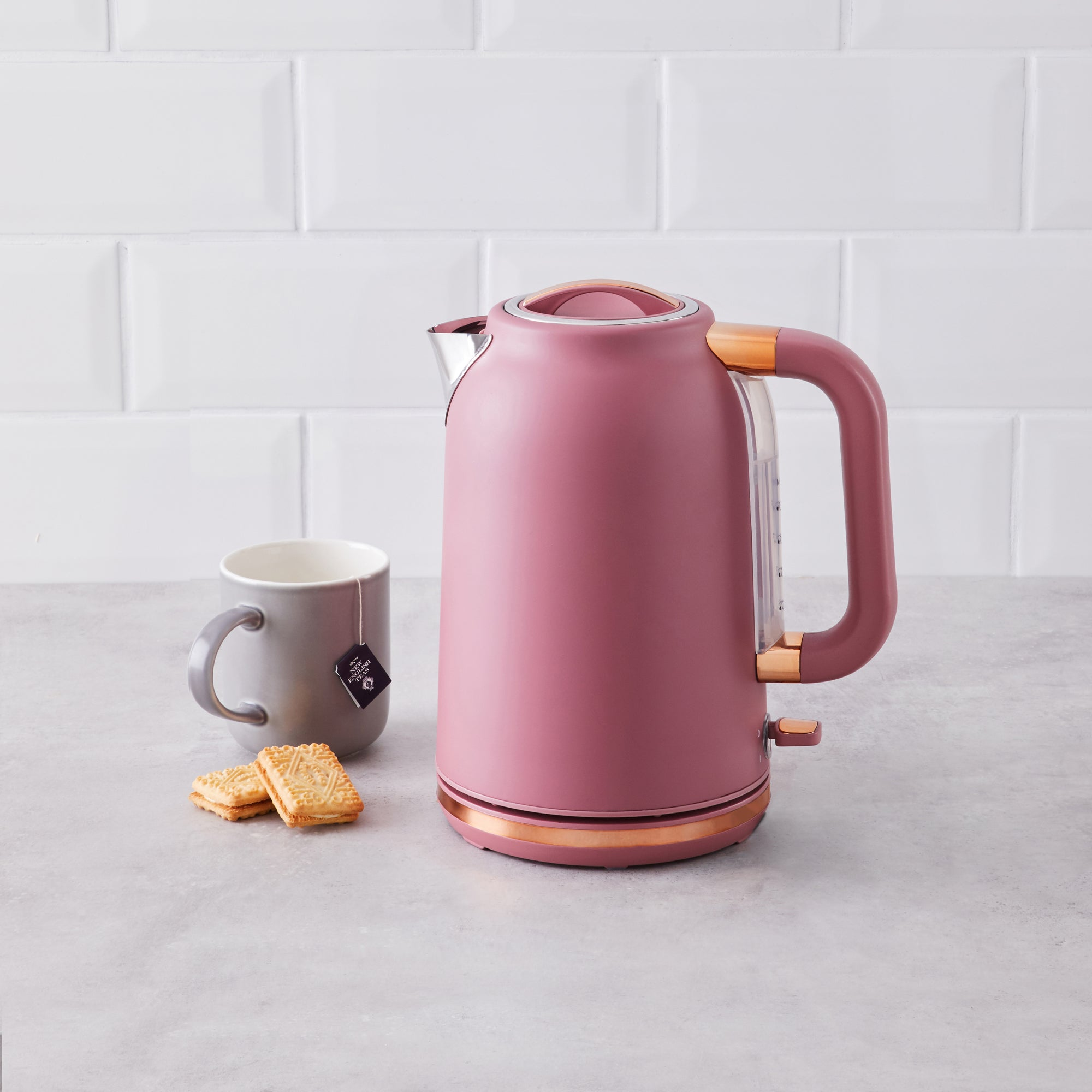 Click to view product details and reviews for Blush With Copper Accents Kettle Pink And Gold.