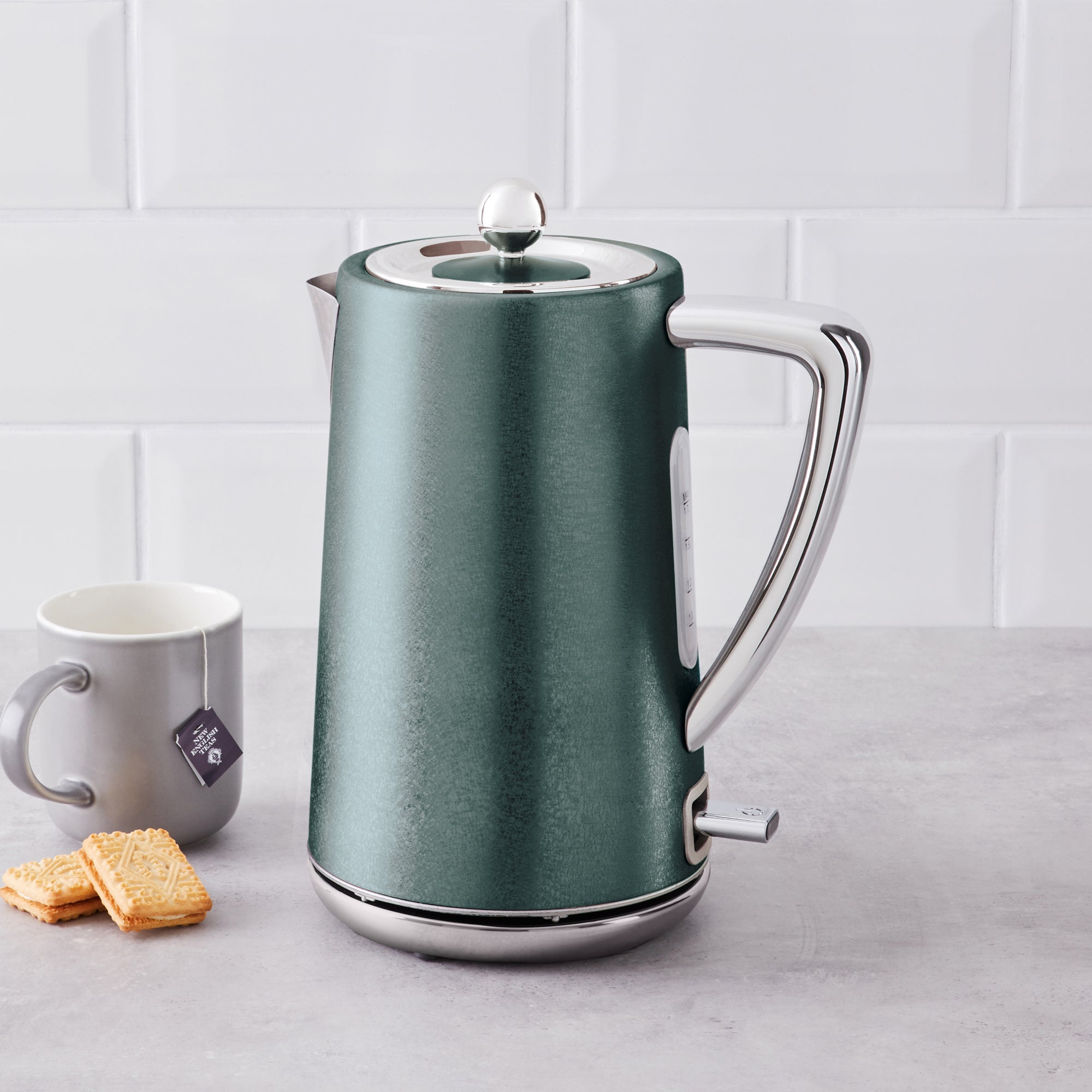 Click to view product details and reviews for Peacock Crackled Effect Kettle Green And Silver.