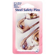 Assorted Sizes Of Safety Pins In A Tin