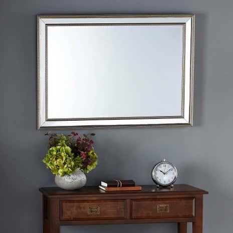 Hang mirror on wall
