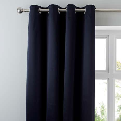 octavia navy blue eyelet blackout curtains dunelm. Black Bedroom Furniture Sets. Home Design Ideas