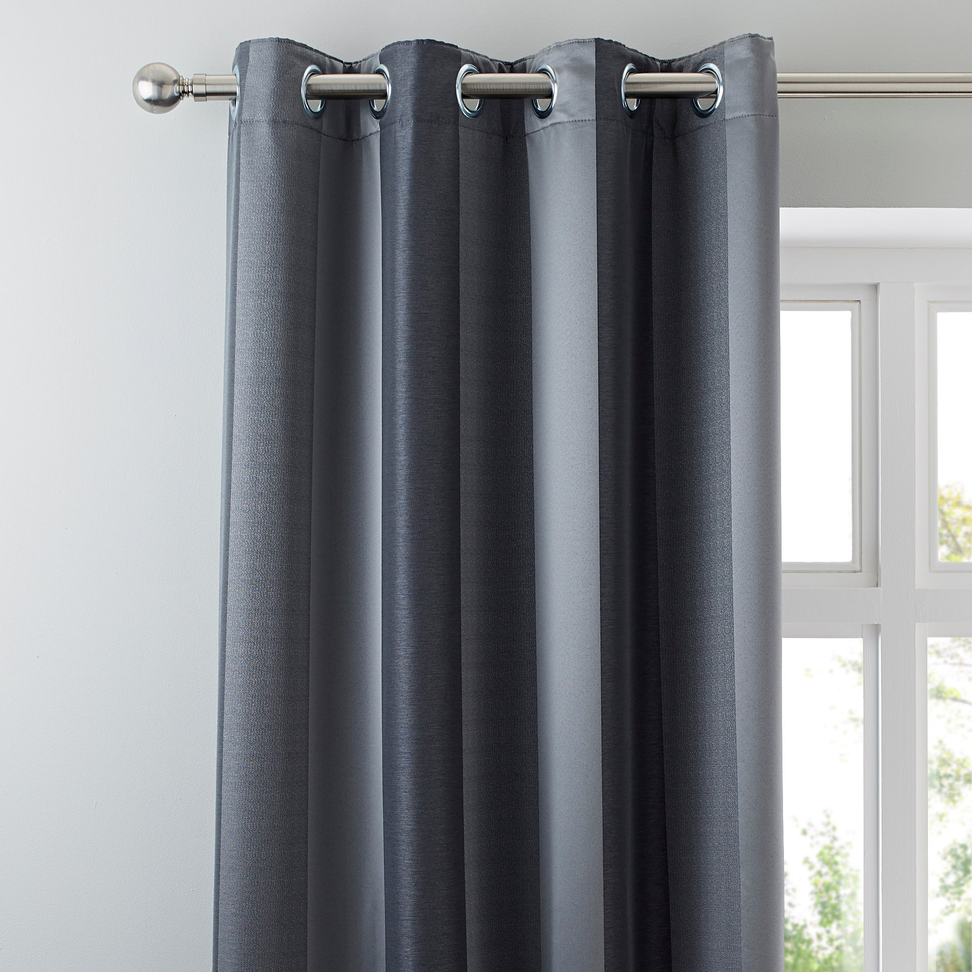 Photo of Monaco pewter lined eyelet curtains dark grey