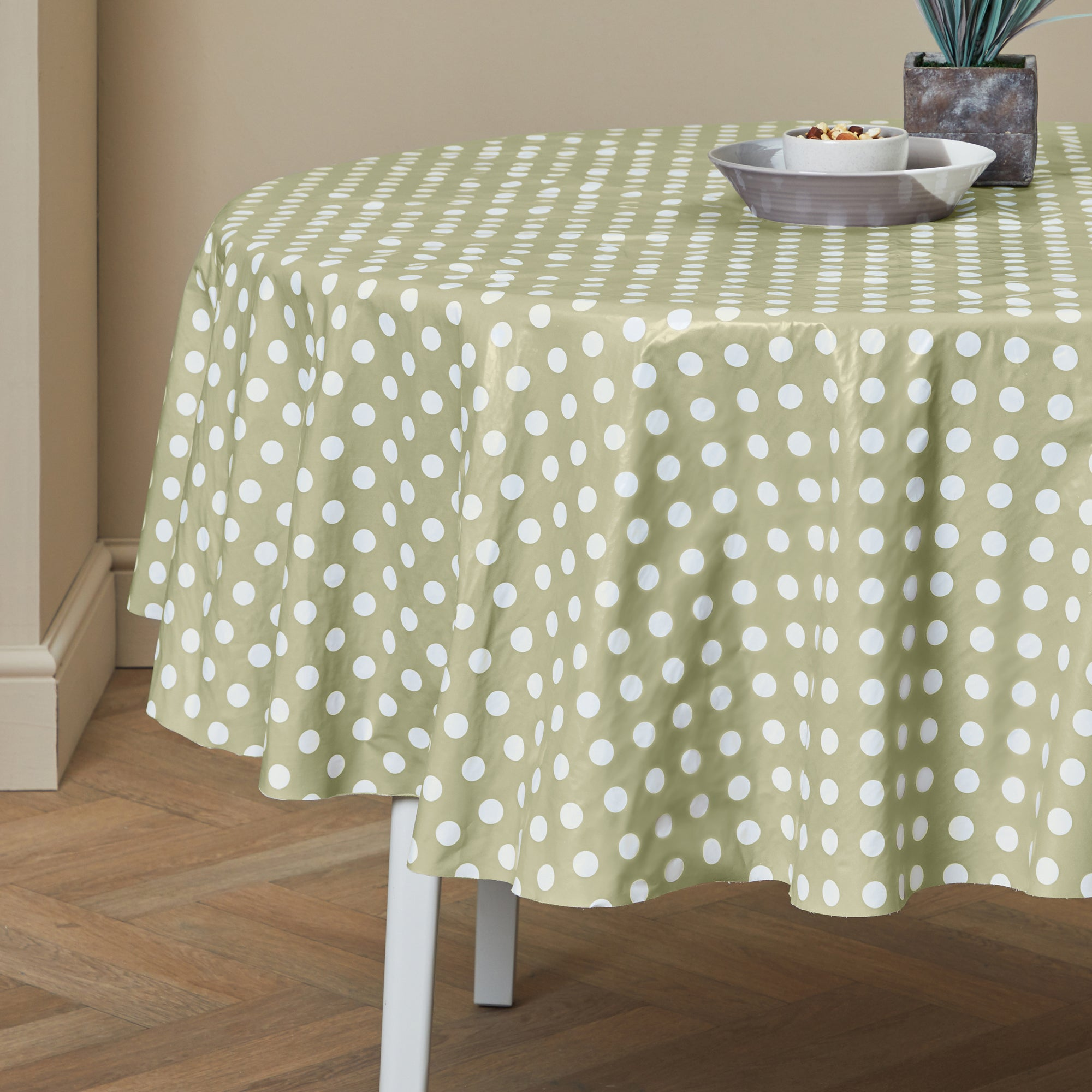 Photo of Dotty round pvc tablecloth green / sage green