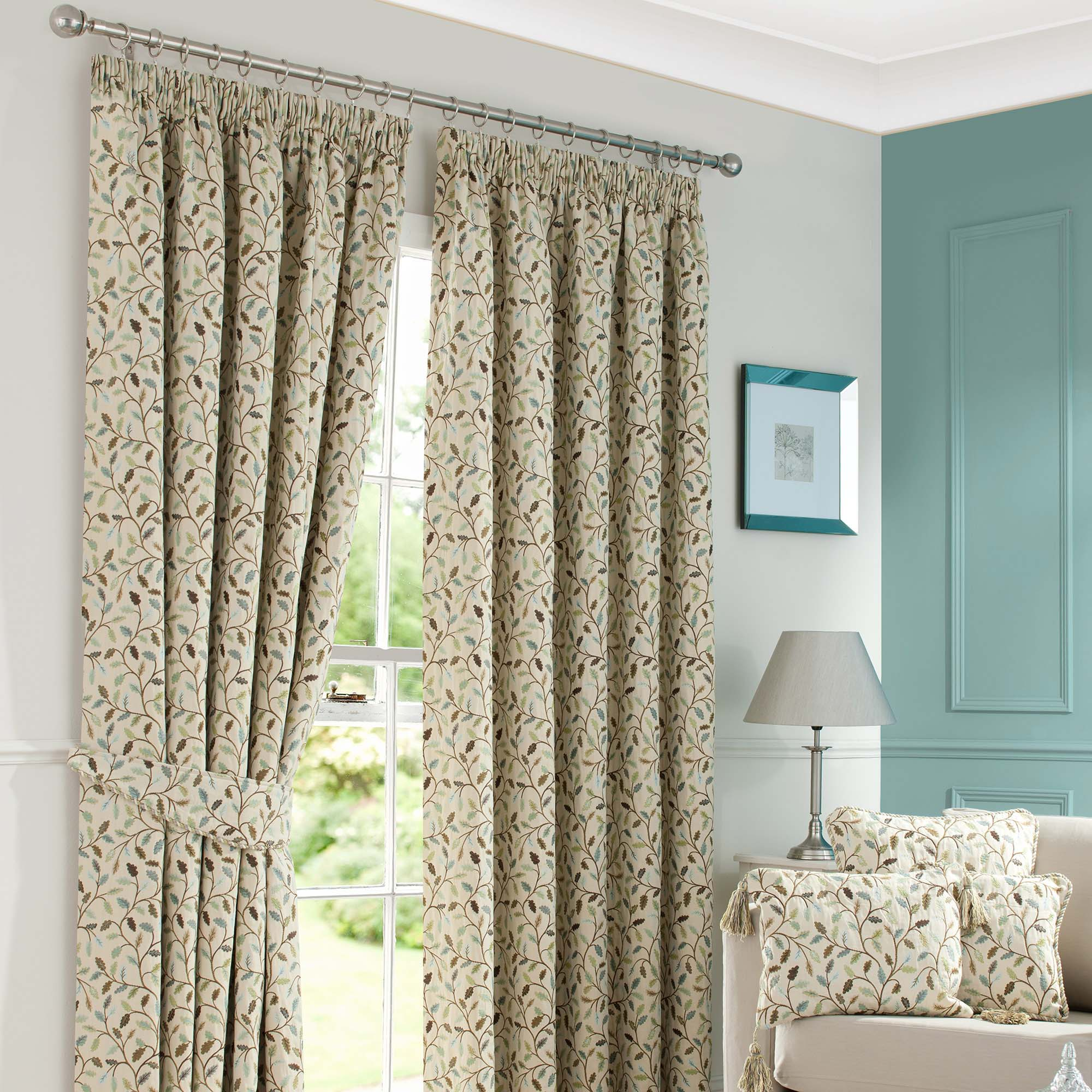 Photo of Heritage glava teal lined pencil pleat curtains cream