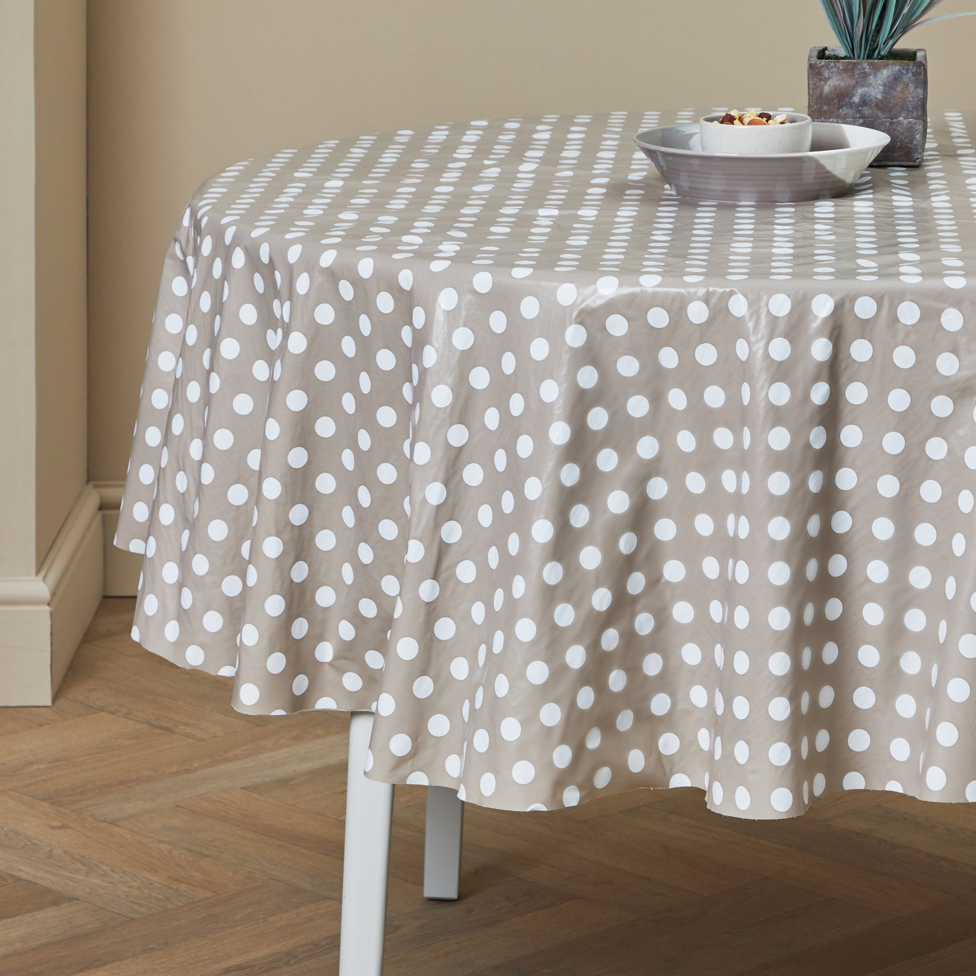 Photo of Taupe dotty round pvc tablecloth taupe