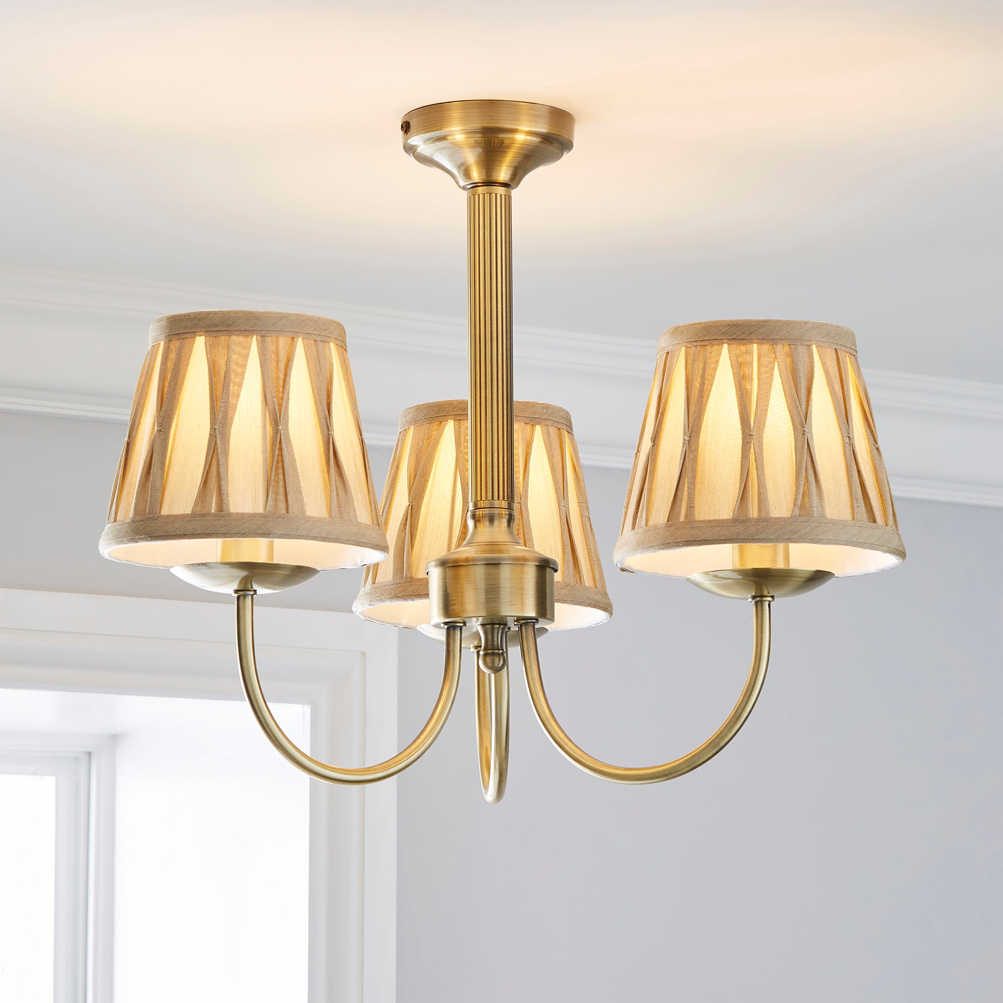 Photo of Reeded champagne 3 light fitting antique brass